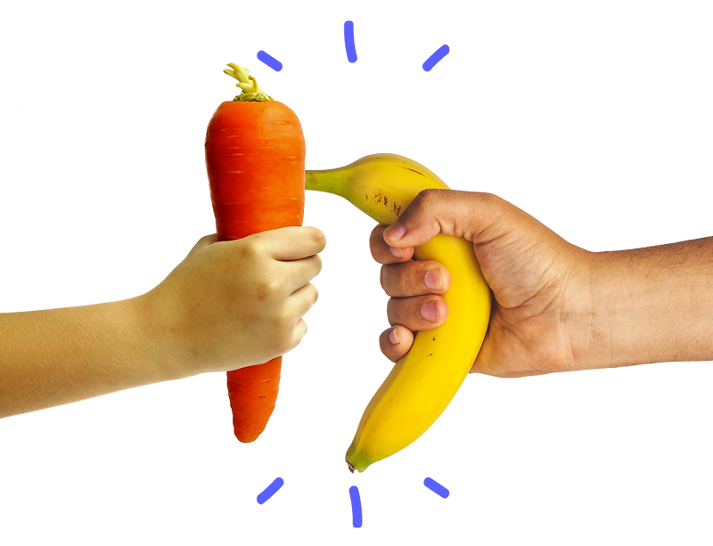 Hands holding a carrot and a banana